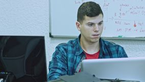 Close up of attractive young man using computer at his working place. Office worker. Close up of attractive young man using computer at his working place stock video