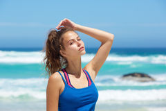 Close up attractive young sporty woman at the beach Royalty Free Stock Images