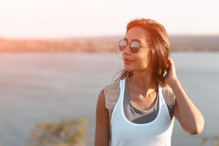 Close up of attractive young woman dreaming on nature. Close up of a romantic and attractive young woman dreaming on nature. Toned vintage filter with sun flare Royalty Free Stock Images