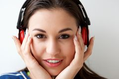 Close up attractive young woman listening to music with headphones. Close up portrait of attractive young woman listening to music with headphones Royalty Free Stock Photos