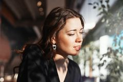 Close up of attractive young woman at lunch break looking aside stock images