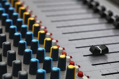 Close up audio control sound mixing console. Board with fader bars, buttons and sliders, high angle view stock photos