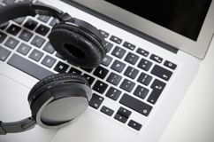 Close up of audio headset on laptop Stock Images