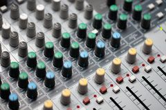 close up audio mixer in the studio. professional music equipment. royalty free stock images