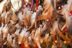 Close up of authentic dreamcatchers with feathers and beads Royalty Free Stock Photo