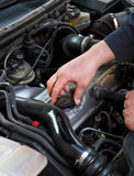 Close up of auto mechanic opens the oil cap Stock Photography