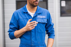 Close up of auto mechanic smoking cigarette Stock Photos
