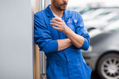 Close up of auto mechanic smoking cigarette Stock Photography