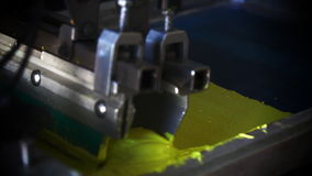 Close Up Automated Silk Screening Machine stock video