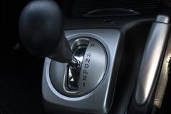 Close up automatic gear stick inside modern car. stock photos