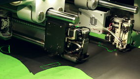 Close-up of automatic machine for cutting leather stock footage