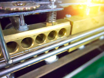 Close up automatic packaging machine.  Royalty Free Stock Images