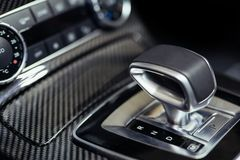 Close-up on automatic transmission lever in modern car. Close-up on new automatic transmission lever in modern car royalty free stock images