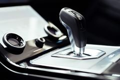 Close-up on automatic transmission lever in modern car. Close-up on new automatic transmission lever in modern car royalty free stock photo