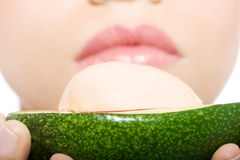 Close up on avocado hel by a beautiful woman. Royalty Free Stock Photos