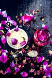 Close up of ayurvedic and beneficial face pack for dull and black skin i.e. Face pack of Rose water with gram flour and some rosa. Petals on wooden surface royalty free stock photo