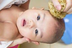 Close up baby bathing stock photography