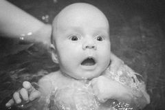 Close up baby bathing on mother hands Royalty Free Stock Images