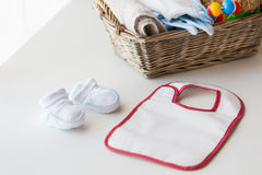 Close up of baby bootees, bib and newborn stuff Royalty Free Stock Image