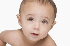 Close-up of a baby boy thinking Royalty Free Stock Photo