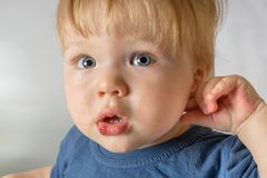 Close-up of baby bruised injured lip after falling. Children traumas concept royalty free stock photo