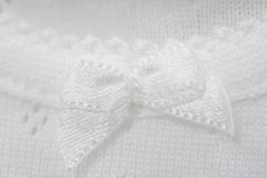 Close up of baby clothes. Full frame close up of bow on babygro royalty free stock images