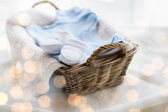Close up of baby clothes for newborn boy in basket Royalty Free Stock Photography