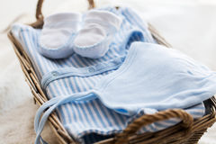 Close up of baby clothes for newborn boy in basket Stock Images