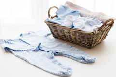 Close up of baby clothes for newborn boy in basket Royalty Free Stock Photo
