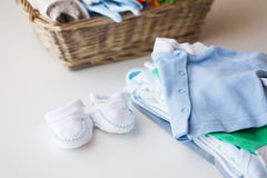 Close up of baby clothes for newborn boy in basket Stock Photos