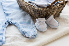 Close up of baby clothes for newborn boy in basket Stock Photography