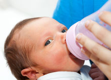Close up of baby drinking his bottle Stock Photo