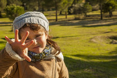 Close up baby girl with give me five expression. In the countryside royalty free stock photos