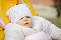 Close up of a baby with a hat outdoors Royalty Free Stock Photo
