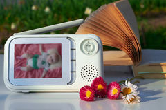 The close-up baby monitor for security of the baby.  Stock Photos