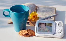 The close-up baby monitor for security of the baby on the table.  Stock Photos