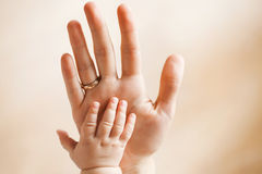 Close-up of baby's hand holding mother's finger with Royalty Free Stock Photo