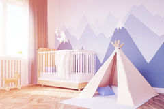 Close up of baby`s room, tent and mountain, toned Royalty Free Stock Photography