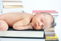 Close-up of baby sleep on the books. Close-up of newborn baby sleep on the books in the library Royalty Free Stock Photography