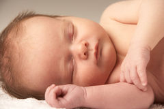 Close Up Of Baby Sleeping On Towel Royalty Free Stock Image
