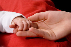 Close-up of babys hand holding hand Stock Images