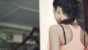 Close up back look of girl's body. Training triceps in the gym stock video