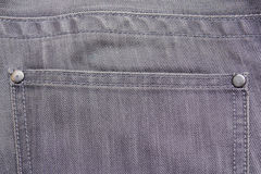 Close up of back pocket on grey jeans Stock Photography