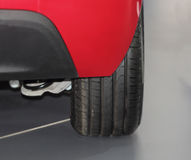 The close up of back red car bumper and wheel. Royalty Free Stock Images