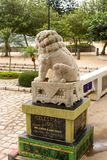 Closeup of back Single Stone lion statue in Repulse Bay Temple,. Close up of back Single Stone lion statue in Repulse Bay Temple, Hong Kong Royalty Free Stock Photography