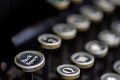 Close up of `back space` key on a vintage manual typewriter. Close up of `back space` key on a black vintage manual typewriter royalty free stock photo