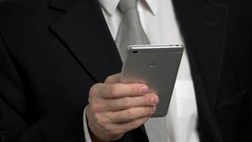 Close-up back view smartphone typing. Smartphone typing by one hand, businessman in suit. Phone back side stock footage