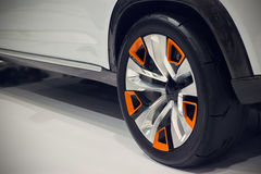 Close up back wheel of a car on the white floor Royalty Free Stock Images