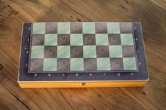 Close up of a backgammon box with a chessboard in one side. View of a Backgammon with a chessboard in one side Royalty Free Stock Photo