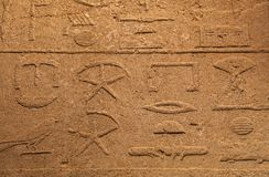 Stone wall with ancient Egyptian hieroglyphs stock photos